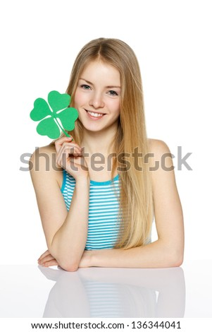 Young female holding leaf symbol, over white background