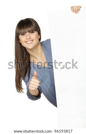 Young female holding the blank board and showing thumb up sign, isolated on white background - stock photo