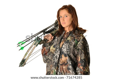 Young female hunter with bow and camouflage isolated on white - stock photo