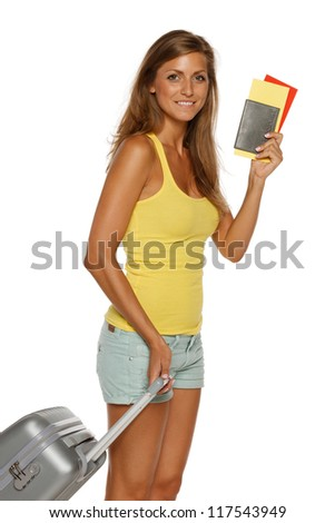 Young female in casual standing with travel bag, holding passport and tickets,over white background - stock photo