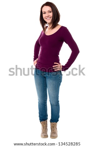 Young female in casuals posing with hands on her waist. - stock photo