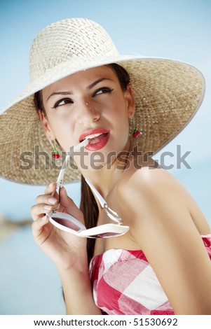 young female in retro summer outfit - stock photo
