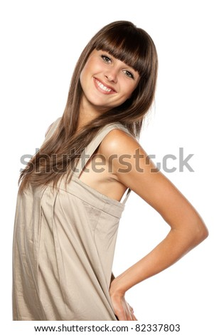 Young female in summer dress posing on the white background - stock photo