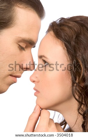 young female in tears comforted by her boyfriend - stock photo