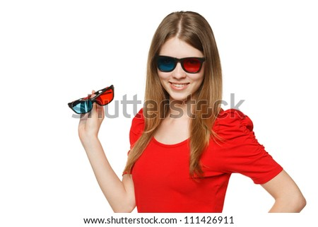 Young female in three-dimensional eyeglasses holding another pair of 3D eyeglasses, against white background - stock photo