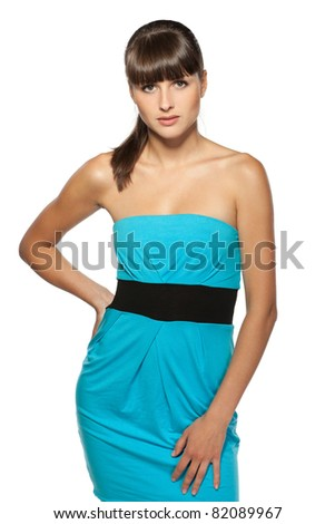 Young female in turquoise cocktail dress posing on white background - stock photo