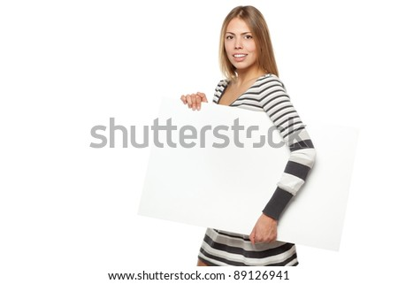 Young female in winter dress carrying a blank billboard, isolated on white background - stock photo