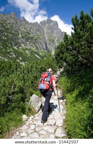 Young female is hiking in Tatra Mountains, Slovakia