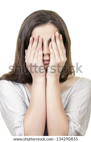 "Young female is making ""See No Evil, Hear No Evil, Speak No Evil"" against white background. - stock photo"
