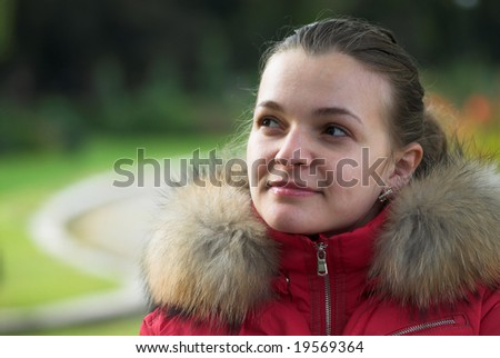 Young female is thinking in the park