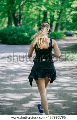 Young female jogger - stock photo
