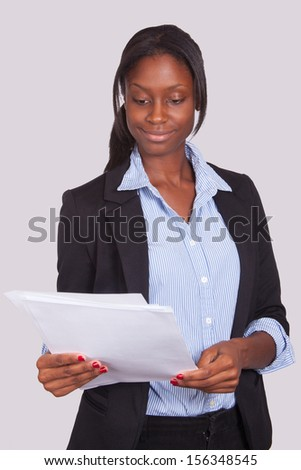 Young Female looking at papers