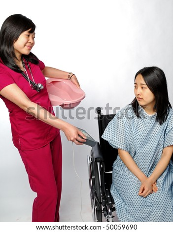 Young female medical professional in scrubs demands payment from patient before giving her a bedpan - stock photo
