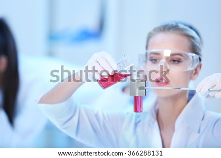 Young female medical technician working in laboratory - stock photo