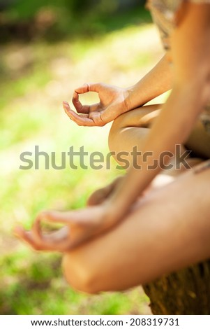 Young female meditate in nature.Close-up image. - stock photo