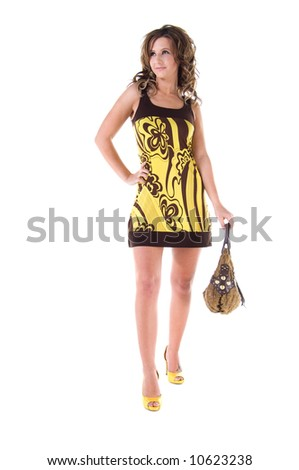 Young female model in a bold floral print mini dress - stock photo
