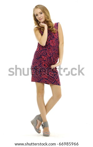 young female model posing against white background