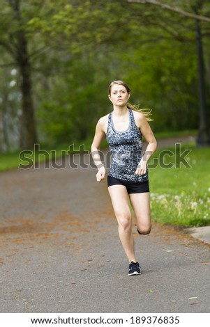 young female model running in the park - stock photo