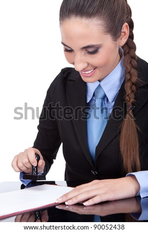 young female notary public stamping  document, isolated on white background - stock photo