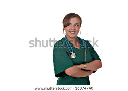 Young Female Nurse Smiling And Looking Sideways With Arms Crossed - stock photo