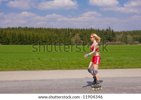 young female on roller skates - stock photo