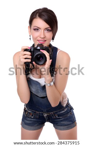 Young female photographer with camera in isolated on white background. - stock photo