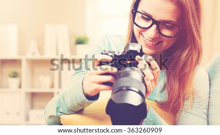 Young female photographer with DSLR camera  - stock photo
