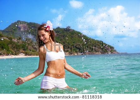 young female playing in open water - stock photo