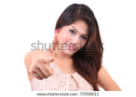 Young female pointing at you - Portrait of an attractive young woman pointing her finger. Isolated on white background