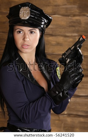 Young female police officer - stock photo