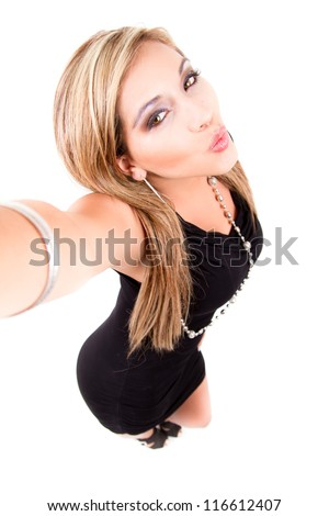young female posing as she is taking picture of herself