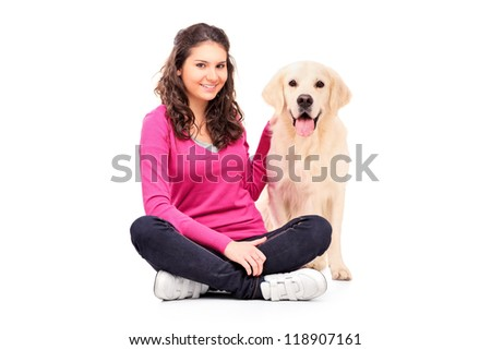 Young female posing with a dog isolated on white background - stock photo