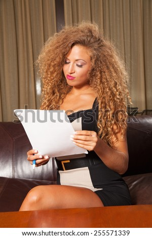 young female reading in the office  - stock photo