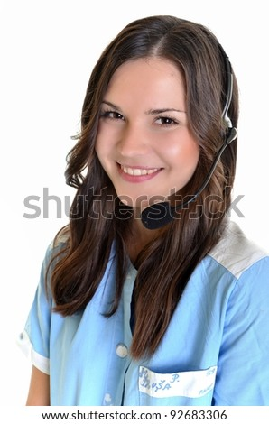 Young female receptionist at clinic reception talking on headset. - stock photo