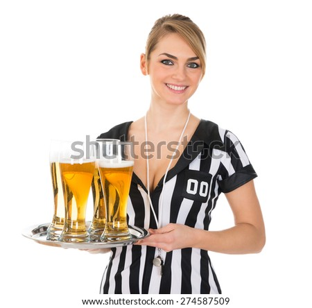 Young Female Referee Holding Tray With Glass Of Beer Over White Background - stock photo