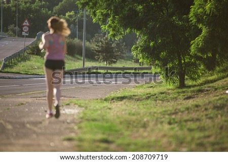 young female running