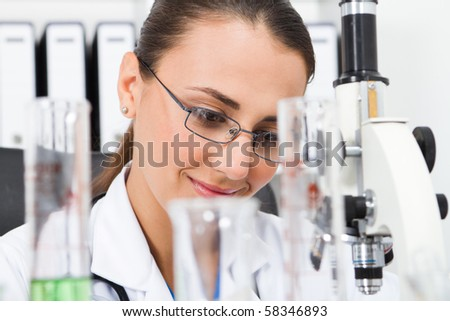 young female science researcher in lab