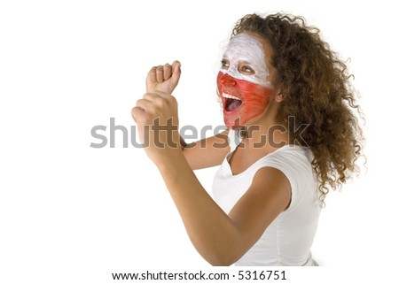 Young female screaming fan with painted Polish flag on face. She's on white background. Side view. - stock photo