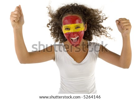 Young female screaming Spanish fan with hands up and painted flag on faces. She's on white background. Front view. She's looking at camera. - stock photo