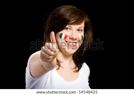 young female show thumb up gesture, italian team supporter with flags on her cheeks, studio shoot isolated on black