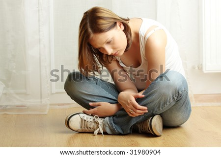 Young female sitting on the flor, stressed out, depressed and tired