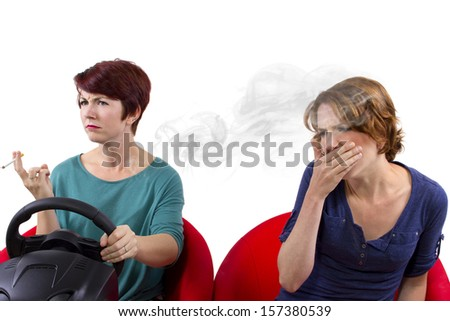 young female smoking while driving on white background - stock photo