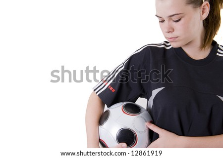 Young female soccer player holding the ball. Isolated on white. - stock photo
