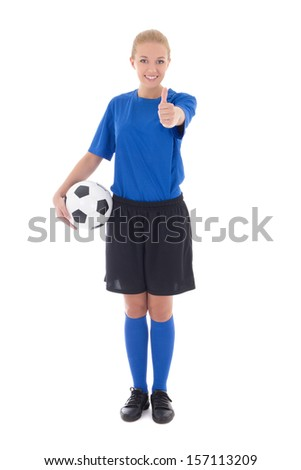 young female soccer player in blue uniform holding the ball thumbs up isolated on white background