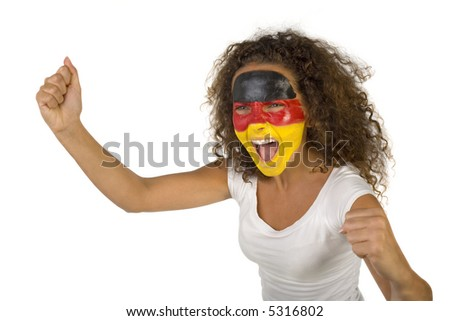 Young female sports fan with painted German flag on face. She's on white background - stock photo