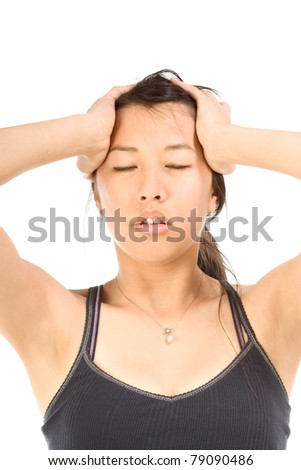 Young female squeezing her head apparently having headache