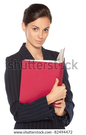 Young female standing with the opened book, isolated on white background - stock photo