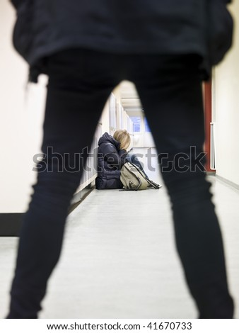 Young female student getting bullied by a male student - stock photo