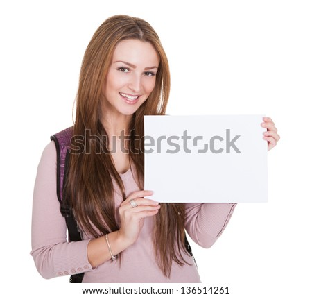 Young Female Student Holding Placard On White Background