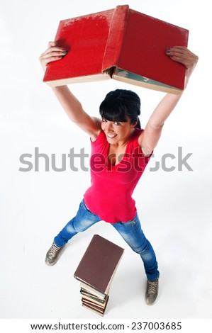 Young female student holding up book - stock photo